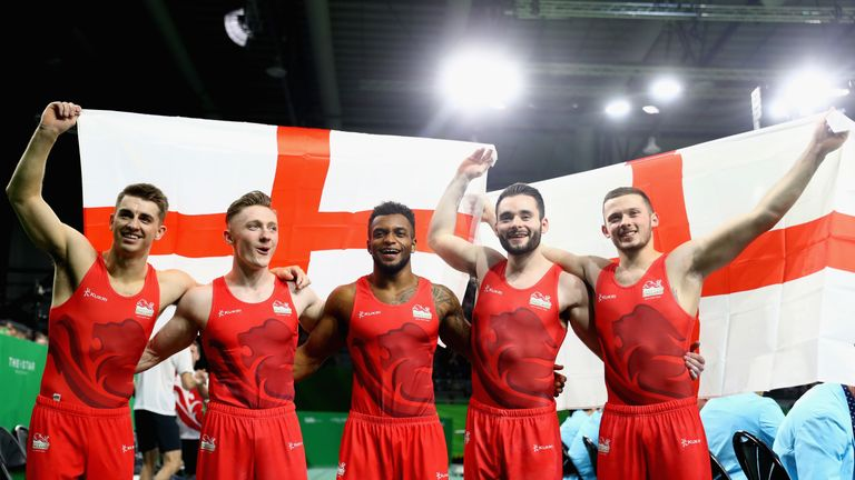 (L-R) England gymnasts Max Whitlock, Nile Wilson, Courtney Tulloch, James Hall and Dominick Cunningham celebrate gold