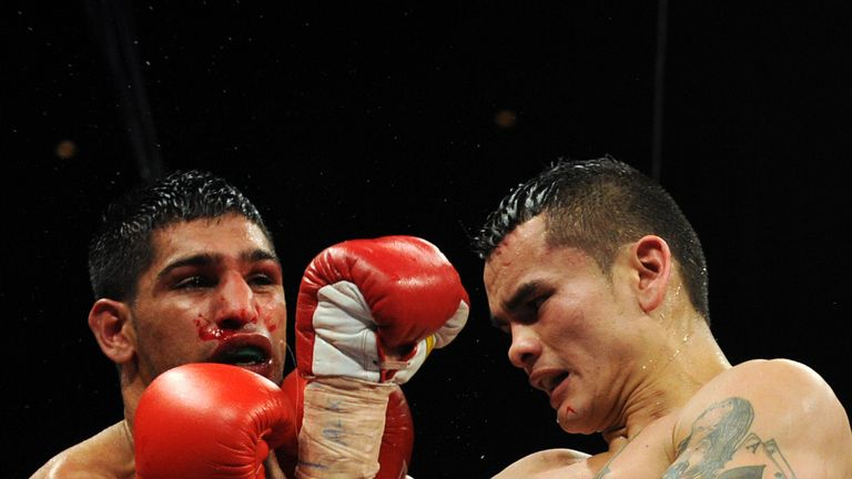 Amir Khan had to take plenty of shots in the second half of the fight - but surived