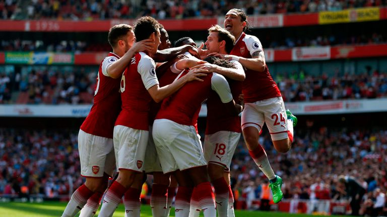 Arsenal players celebrate Nacho Monreal's opener