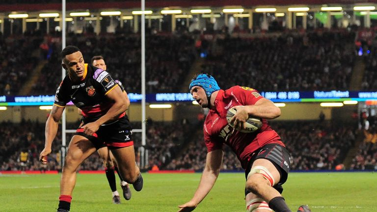 Tadhg Beirne scores for the Scarlets against the Dragons
