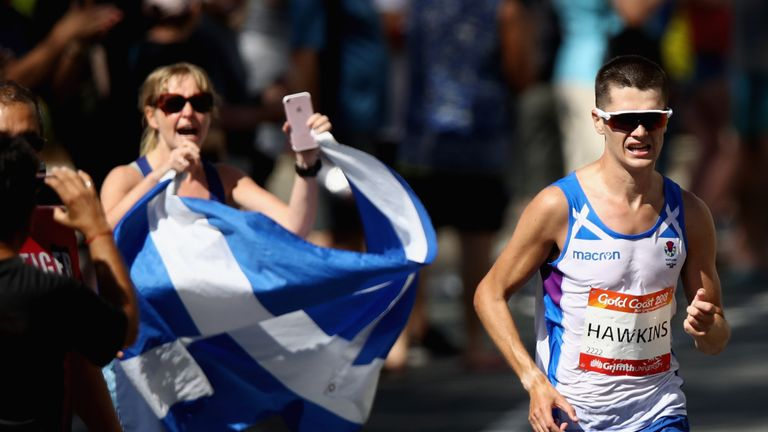 Hawkins was leading the Commonwealth Games marathon before his collapse
