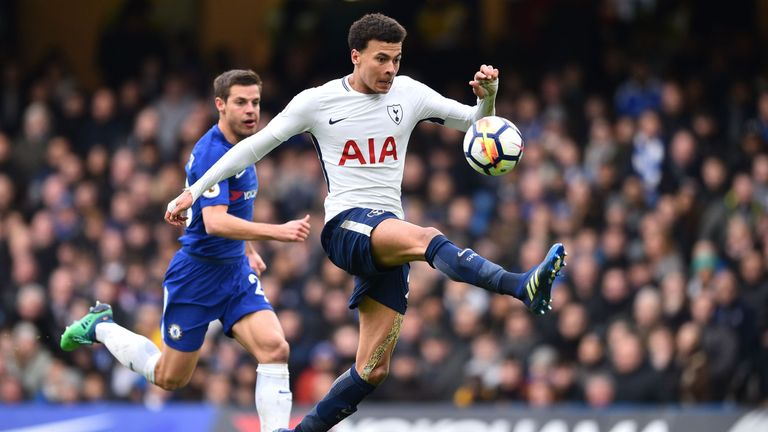 Dele Alli in action with Chelsea's Cesar Azpilicueta