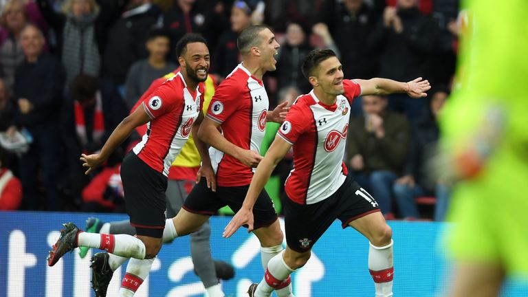 Tadic celebrates with Nathan Redmond and Oriol Romeu after putting Southampton back in front at St Mary's