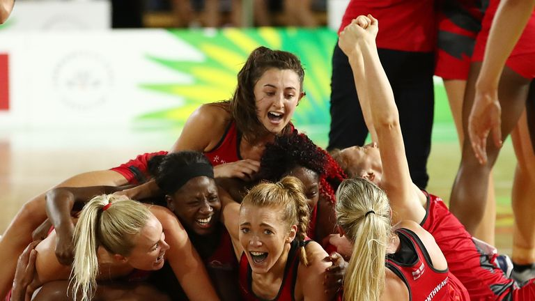 A jubilant Roses squad celebrate their first major medal at world level