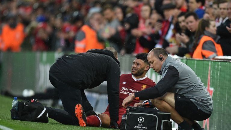 Alex Oxlade-Chamberlain suffers an injury against Roma