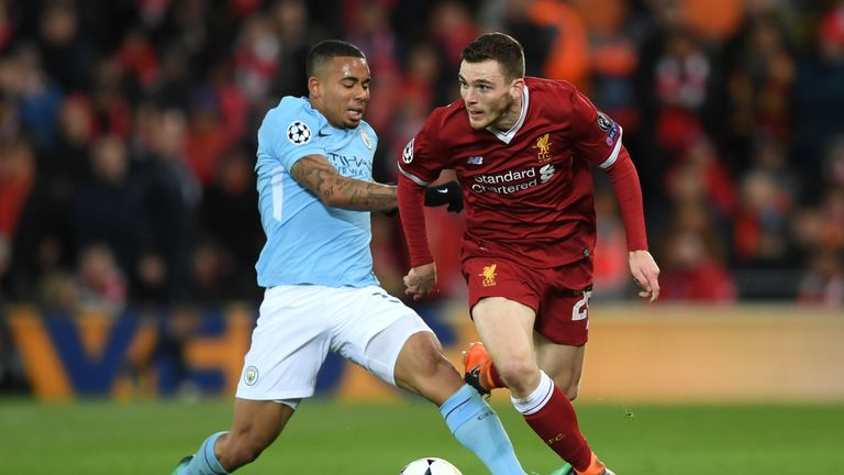 Andy Robertson of Liverpool is challenged by Gabriel Jesus of Manchester City