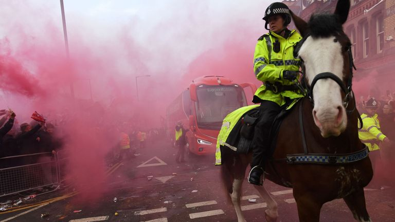 Police keep control as Liverpool's team bus arrives before the game