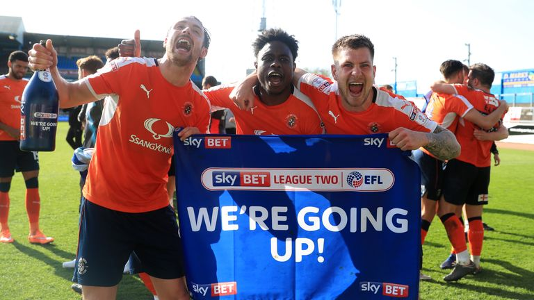 Luton Town's Danny Hylton (left), Pelly Ruddock-Mpanzu (centre) and James Collins celebrate promotion
