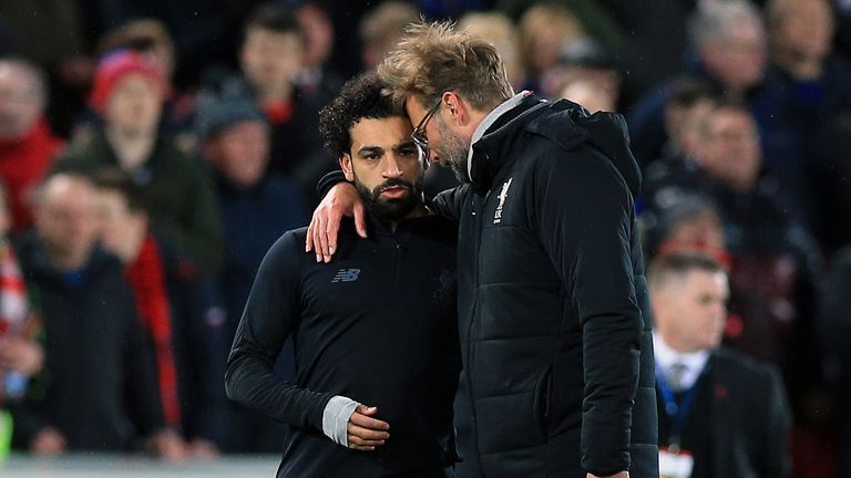 Jurgen Klopp catches a moment with Mohamed Salah after Liverpool's 3-0 defeat of Manchester City