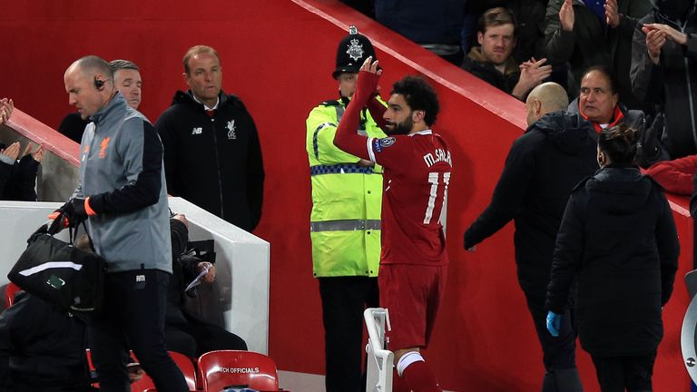 Mohamed Salah applauds the fans as he leaves the field at Anfield
