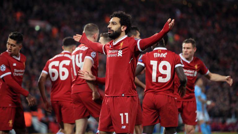 Mohamed Salah (C) celebrates scoring Liverpool's opening goal