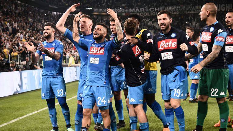 Napoli players celebrate with the fans after their late win against Juventus