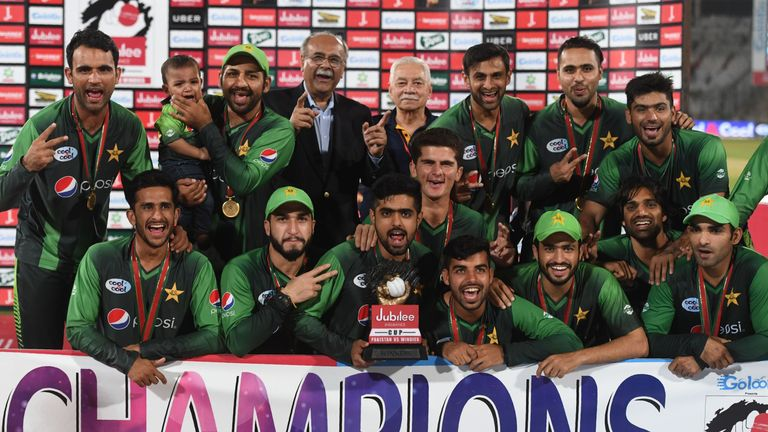 Pakistan's squad celebrate their 3-0 T20 series win over the West Indies