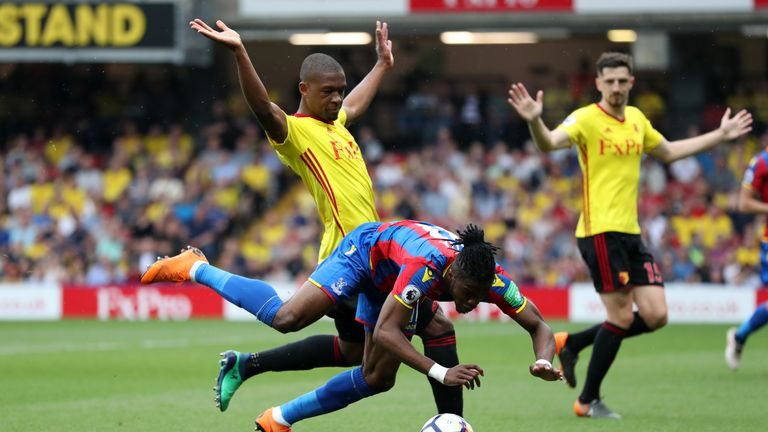 The first penalty shout saw Wilfried Zaha go down after tangling with Christian Kabasele
