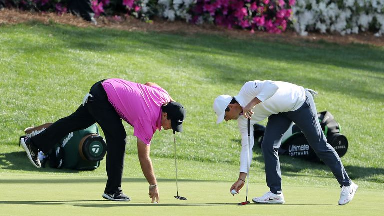 The battle between Reed and McIlroy faded around the turn