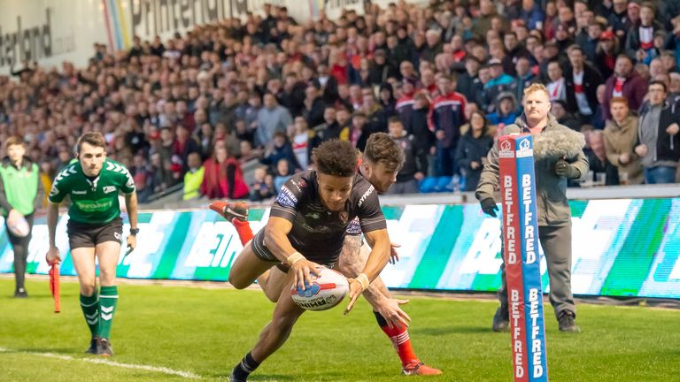 Regan Grace scores one of St Helens' 11 tries at the AJ Bell Stadium