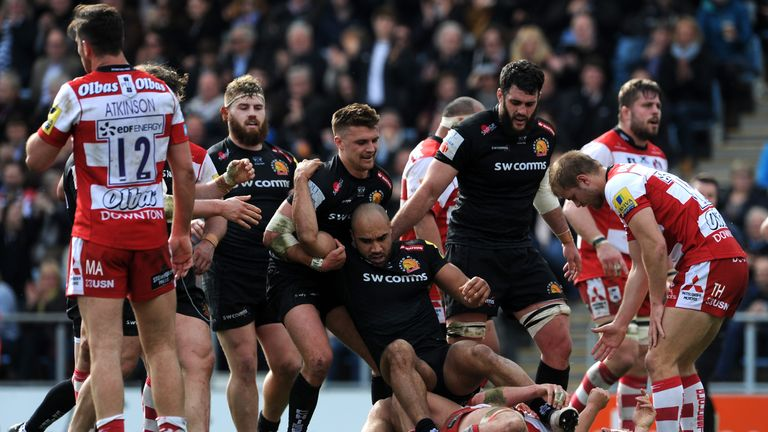 Olly Woodburn is picked up by Slade after scoring Exeter's third try