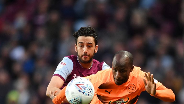 Reading's Sone Aluko challenges for the ball