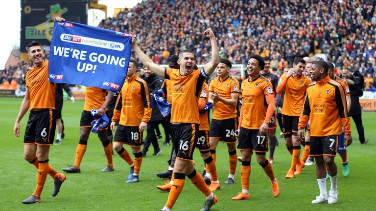 Conor Coady and his team-mates celebrate winning promotion to the Premier League