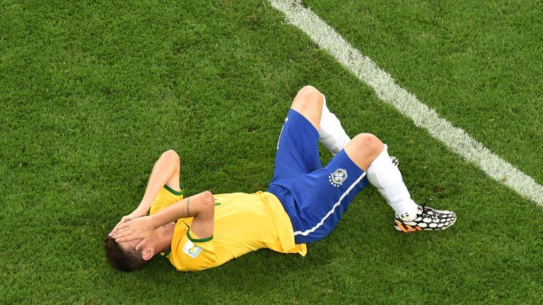 Oscar reacts after Brazil's 7-1 defeat to Germany in 2014