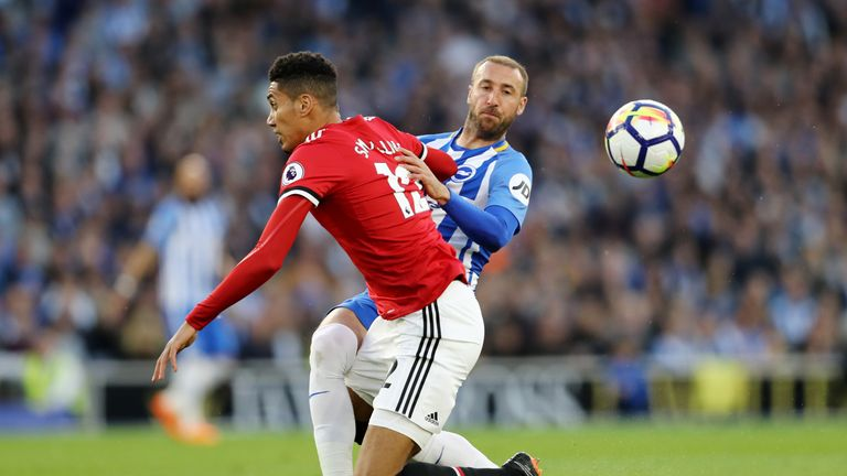 Chris Smalling challenges Glenn Murray in the opening exchanges at the Amex