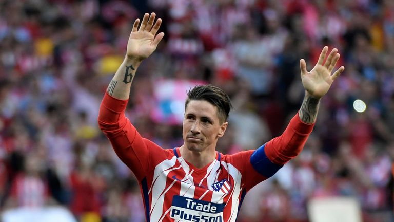 Fernando Torres salutes the fans following his final appearance for Atletico Madrid