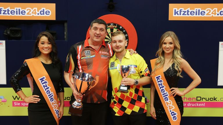 Mensur Suljovic (L) overcame Dimitri Van den Bergh 8-2 in the final (Credit: PDC)