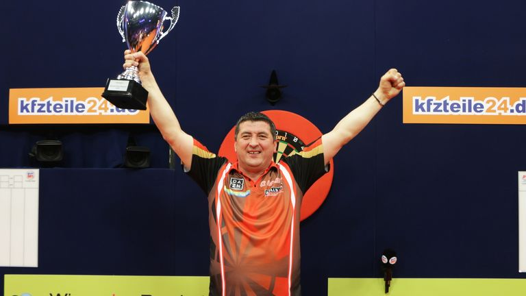 Mensur Suljovic won the German Darts Masters in front of a record-breaking 20,000 fans (Credit: PDC)