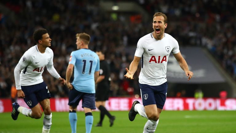 Harry Kane celebrates scoring the opening goal of the game