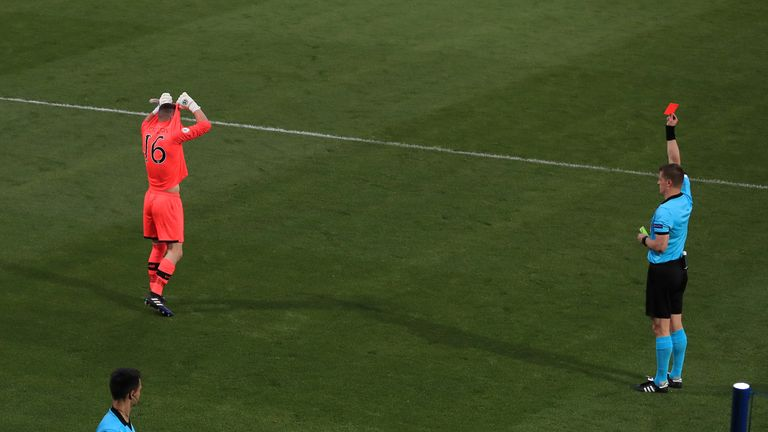 Referee Zbynek Proske sends off Republic of Ireland's goalkeeper James Corcoran during the penalty shoot out