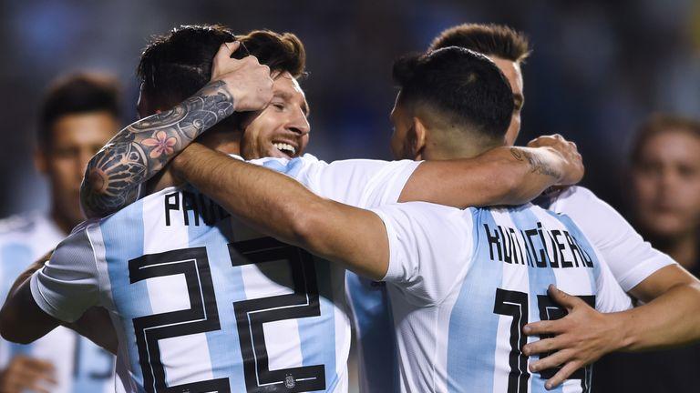 Lionel Messi celebrates with his team-mates after scoring against Haiti