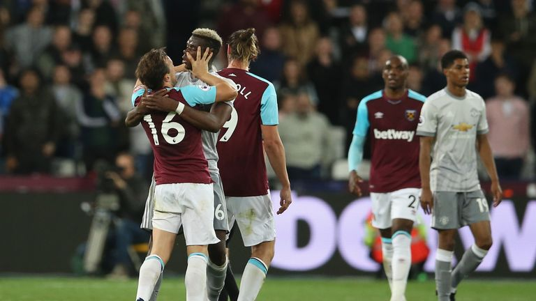 Mark Noble was seen putting his hands in the face of Paul Pogba