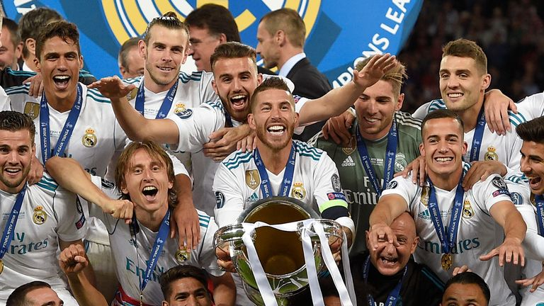 Real Madrid celebrate with the Champions League trophy after their 3-1 win over Liverpool