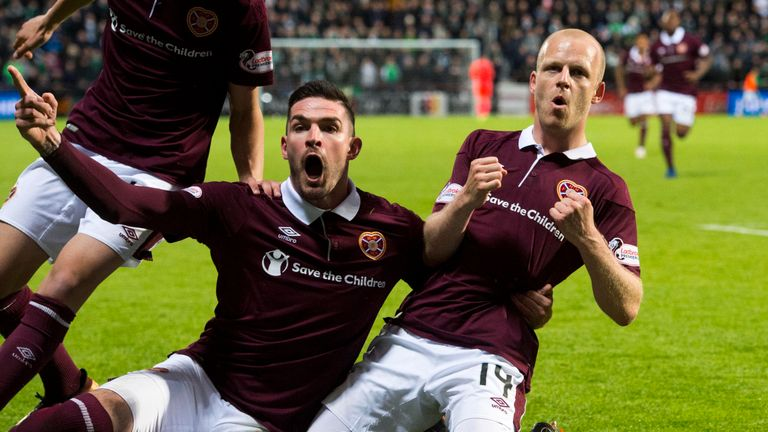 Kyle Lafferty (L) has played for Hearts since 2017 and has scored 12 goals