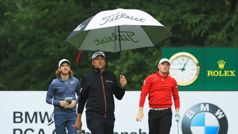 Ian Poulter, Tommy Fleetwood and Matt Wallace had to deal with the early morning rain