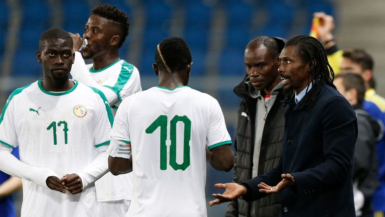 Aliou Cisse gives instructions to his players during a recent friendly