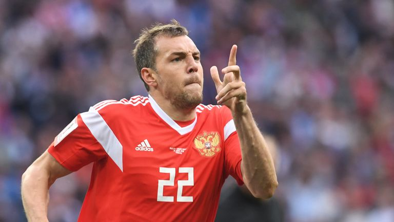 Artem Dzyuba celebrates after scoring Russia's third goal