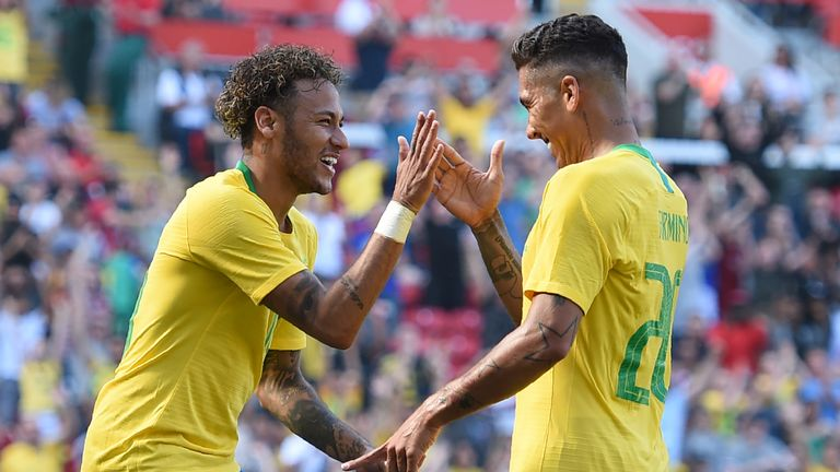 Brazil's Neymar celebrates his goal-scoring return to action against Croatia with Roberto Firmino