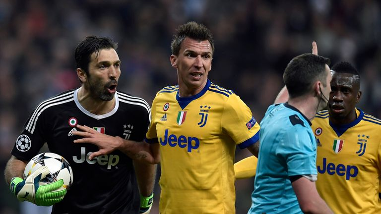 Buffon reacted angrily towards referee Michael Oliver