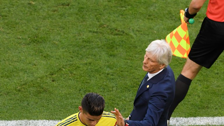 Jose Pekerman speaks to Rodriguez as he leaves the field
