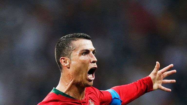 Cristiano Ronaldo's first World Cup hat-trick helped Portugal to a 3-3 draw with Spain