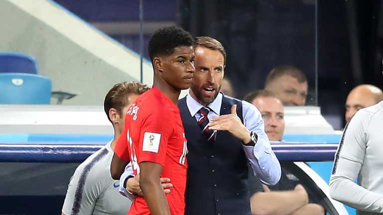 England manager Gareth Southgate gives Marcus Rashford some last-minute instructions before introducing him against Tunisia