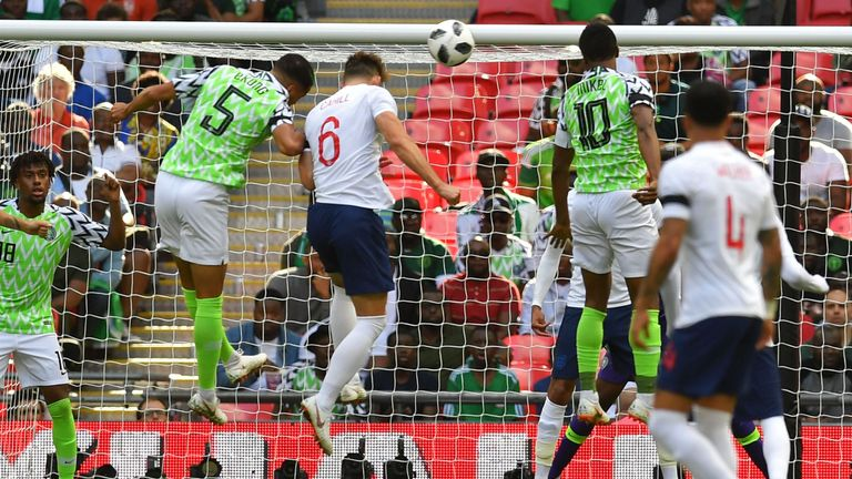 Gary Cahill (centre) scores England's opening goal against Nigeria