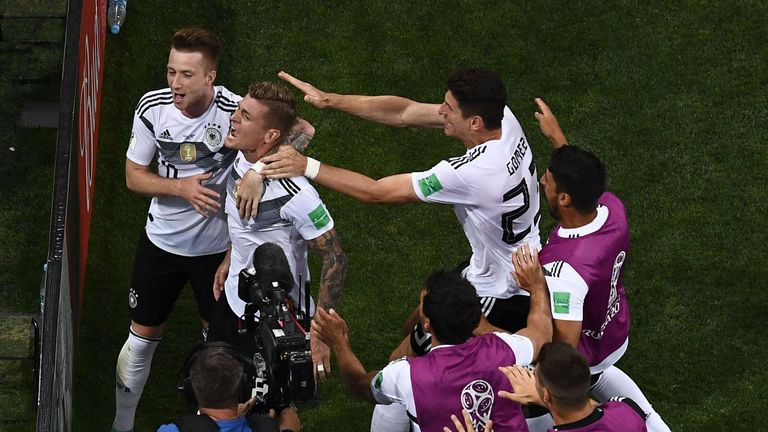 Germany players celebrate Kroos' last-gasp winner against Sweden