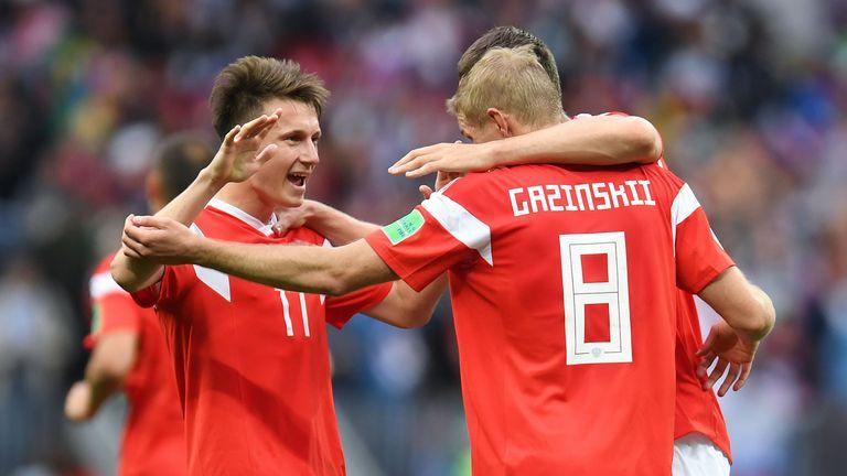 Aleksandr Golovin (left) soared into runner-up spot in the Power Rankings after a 5-0 win against Saudi Arabia