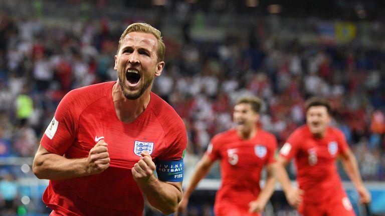 Harry Kane celebrates his late winner against Tunisia