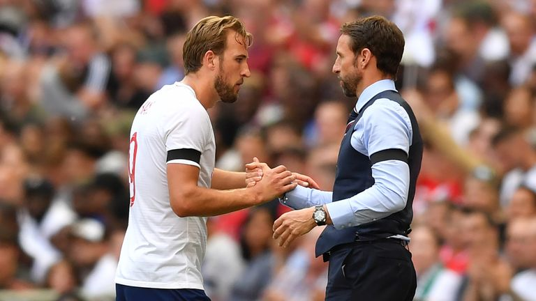 Kane and Gareth Southgate embrace during England's match against Nigeria at Wembley.