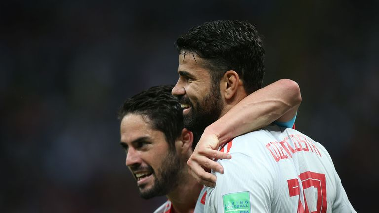 Isco celebrates with Diego Costa after Spain's goal