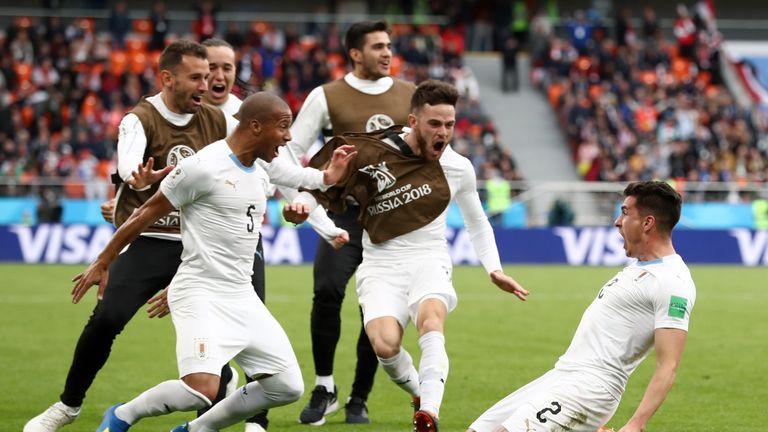 Jose Gimenez celebrates his last-gasp winner with Uruguay team-mates