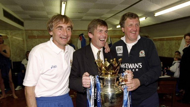 Dalglish (centre) celebrates winning the Premier League